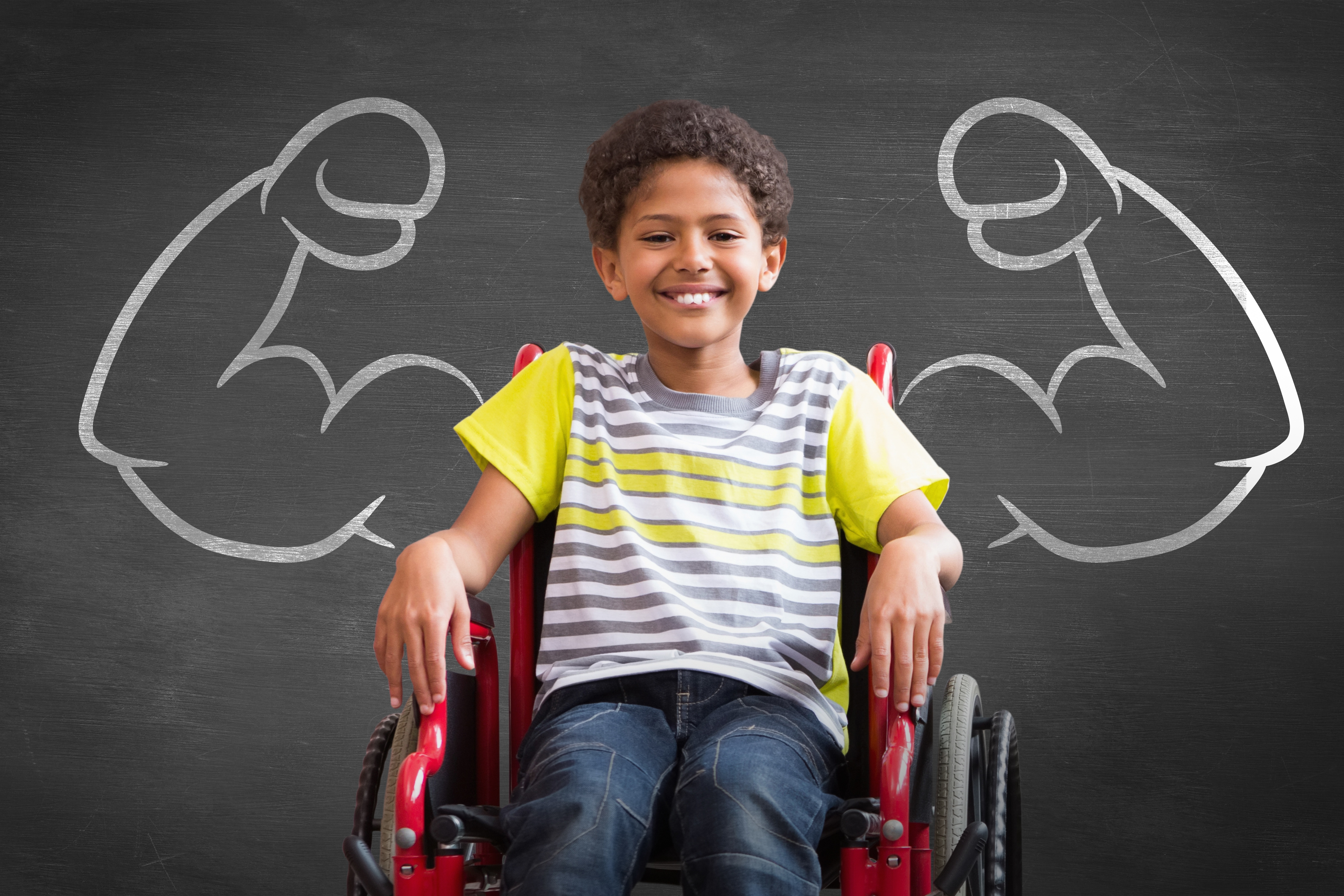 Boy in front of blackboard drawing of muscular arms. Boy is in a red wheelchair.